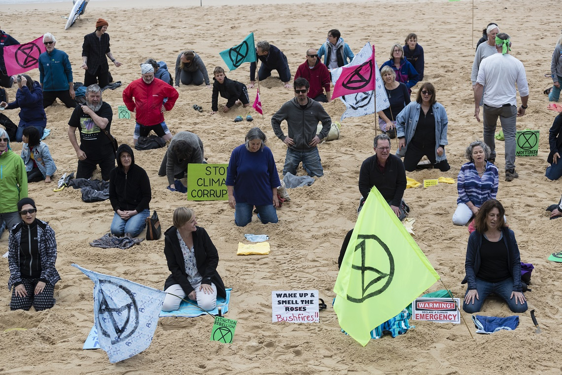 Australian XR activists bury their heads in the sand