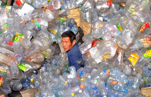 A man drowning in plastic bottles