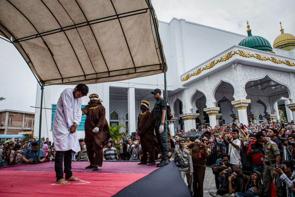 gay men caned aceh