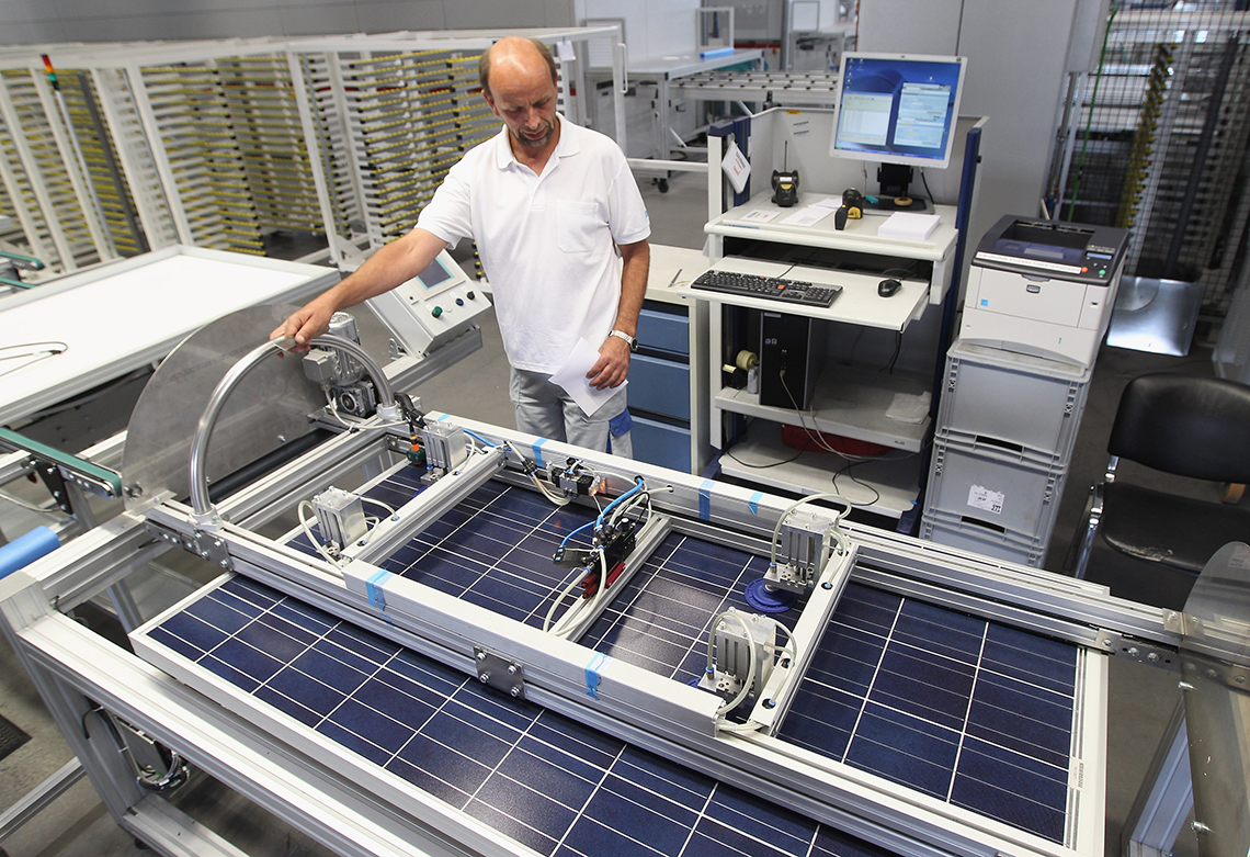 germany factory worker building solar panels