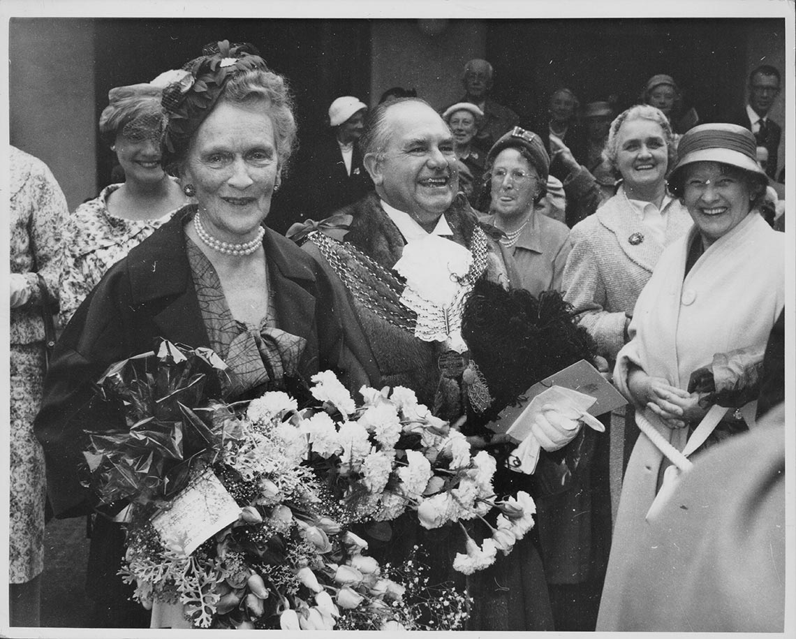 Lady Nancy Astor with Lord Mayor Washbourn, holding a large bouquet of flowers as she is greeted by well-wishers, following the ceremony to make her the first woman presented with the Freedom of the City of Plymouth, England, July 17th 1959. Photo by Central Press/Hulton Archive/Getty Images