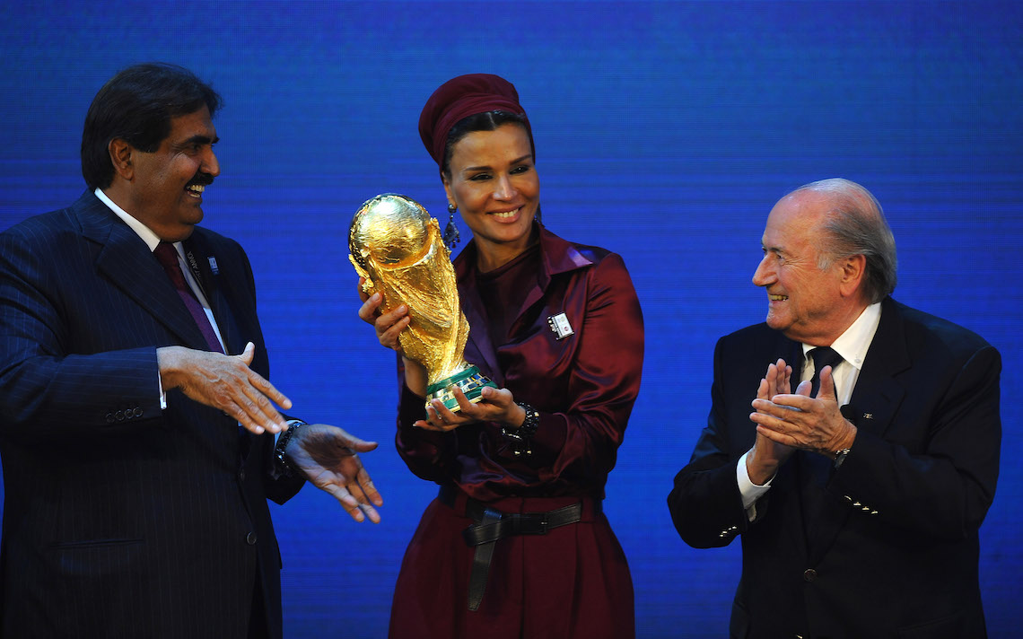 ZURICH, SWITZERLAND - DECEMBER 02: The Emir State of Qatar HH Sheikh Hamad bin Khalifa Al-Thani and Sheikha Mozah bint Nasser Al Missned are presented with the World Cup Tophy by FIFA President Joseph S Blatter after winning the bid for 2022 duirng the FIFA World Cup 2018 & 2022 Host Countries Announcement at the Messe Conference Centre on December 2, 2010 in Zurich, Switzerland.  (Photo by Laurence Griffiths)