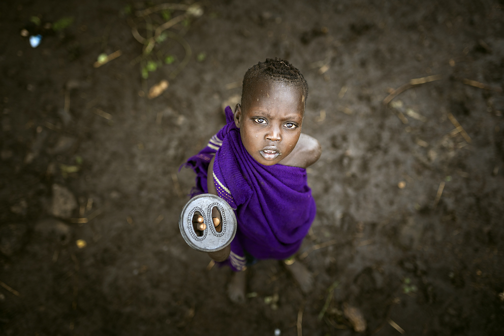 lower omo valley, ethiopia, tribes, reportage, mursi girl, lip plate, tourism